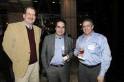 Business Journal staff writer Mark Anderson poses for a photo at the Book of Lists party with Stephane Come and Steve Simonetto of LCS Technologies.