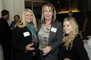 Professionals from Robert Half International join business leaders for networking and good food at the Business Journal's Book of Lists party Monday night.