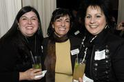 Business leaders and members of the community gathered for networking and good food at the Business Journal's Book of Lists party Monday night. At center is Deb Galvez of the Business Journal.