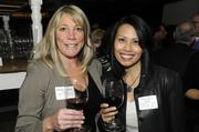 Michele Reesink of Glumac and Tracy Librea-Asunto of Willams & Paddon post for a picture at the Book of Lists party.