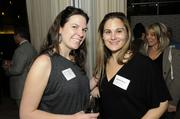 Cathy Kleckner of Art Consulting Services and Angelina Bravo of BSK Associates pose for a photo at the Book of Lists party on Monday night.