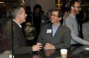 Business Journal editor Jack Robinson chats with Steve Weiss of The Weiss Group  at the Book of Lists party Monday night at Ella Dining Room & Bar.