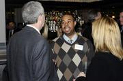 Charles Nelson from the Sacramento Kings converses with business leaders at the Book of Lists party on Monday.