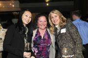 Theresa Saechao and Delania Lustig of the Business Journal's audience development department with Cindi Chilelli of Fat's Catering pose for a photo at the Book of Lists party on Monday night.