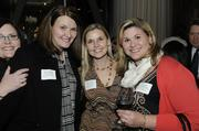 Erica Taylor of Five Star Bank, Stacy Garland of Modamedia Communications and Jennifer Castleberry of Modamedia Communications pose for a photo at the Business Journal's Book of Lists party Monday night.