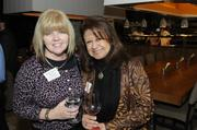 Debbie Struhm of Roebbelen Contracting and Rose Cottle of NTD Architecture pose for a picture at the Business Journal's Book of Lists party Monday night.