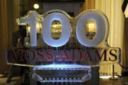 An ice sculpture commemorates the 100th anniversary of sponsor Moss Adams LLP at the Book of Lists party at Ella Dining Room & Bar.