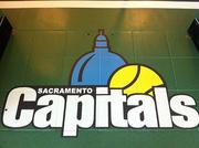 The new logo for the Sacramento Capitals can be seen at the new office of the tennis team. The office might make visitors feel like they're already at the stadium with a wrap that looks like a tennis court, complete with spectators.