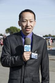Sacramento Asian-language television station Crossings TV has expanded its reach to three additional Comcast markets: Chicago, Seattle and San Francisco. Here, a reporter covers an event. The company produces its own news and entertainment programming, including covering local events such as the Chinese New Year parade and the Yuba City Marysville Sikh Festival, and also pays for movies and other high-level entertainment.
