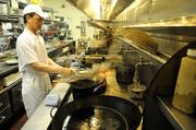 Chef Jim Ma prepares food in a wok in the kitchen of Frank Fat's restaurant in downtown Sacramento.