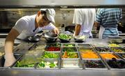 Chef Jim Ma gathers ingredients to transfer into a wok in the kitchen of Frank Fat's restaurant in downtown Sacramento.