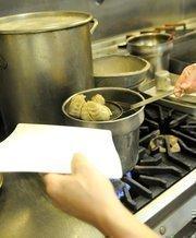 Kitchen staff boil pot stickers to heat them through at Frank Fat's restaurant in downtown Sacramento.