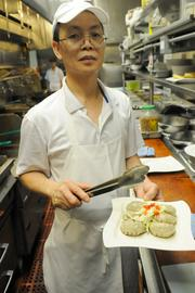 Chef Jim Ma presents pot stickers in the kitchen of Frank Fat's restaurant in downtown Sacramento.