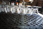Glasses are lined up at the bar at the Firestone Public House. The restaurant is opening soon after a complete remodel of the space that used to be the downtown California Pizza Kitchen.