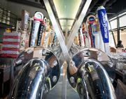 A view of beer taps at the Firestone Public House. The 5,900-square-foot restaurant, a former California Pizza Kitchen, was remodeled.