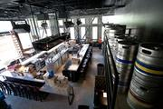 Overview of the Firestone Public House. The restaurant and bar will feature huge flat-screen televisions tied into a digital sound and video system.
