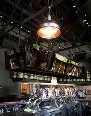 View of the bar and overhead lights at the Firestone Public House.