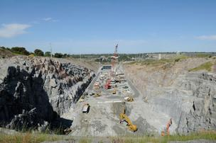 Construction is well under way for the $962 million Folsom Dam auxiliary spillway