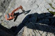 Rock is excavated from the sub foundation of the control structure at the Folsom Dam auxiliary spillway. The project is designed to help the Sacramento region achieve a 200-year level of flood protection.