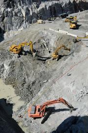 Rock is excavated from the sub foundation of the control structure at the Folsom Dam auxiliary spillway. Six tainter gates will be built for water releases.