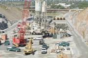 A concrete batch plant is used to supply materials used in the auxiliary spillway project in progress at Folsom Dam.