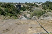 A 700-foot stepped chute is seen at the Folsom Dam auxiliary spillway project. The last 100 feet will have 68 steps to slow the speed of water before it enters the American River.