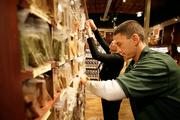 Bulk specialists Antonio Salazar and Rachel Booker stock the bulk spice section at The Fresh Market in Roseville.