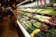 The produce section at The Fresh Market. The store is said to be designed similar to a European market. Lighting is soft and everything is put at easily reached levels.