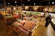 Shoppers browse at The Fresh Market in Roseville.