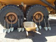 Executives of Sutter Gold Mining used gold-painted shovels and a gold-painted wheelbarrow to set the foundation at a dedication ceremony May 11 at the Lincoln Mine. The company will have invested more than $50 million by the end of the year, just to get the mine operational.