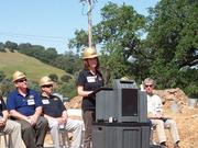 Leanne Baker, president of Sutter Gold Mining, tells the audience that the mining community around the world is watching her company. This is the first large-scale hard rock mine to gear up operations in California's Mother Lode since World War II.