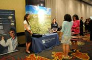 Ashley Burkett and Gladys Ramos of Hill Physicians Medical Group share information before the event.