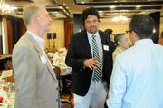 Jeff Farley, Michael Zari and Justin Wise chat before the health care reform panel.