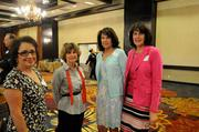 Cerrina Jensen, Gayle Dax-Conroy, Wendy Pouliot and Heidi Duncan wait for the health care reform panel discussion to begin.