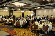 Attendees of the health care reform panel breakfast wait for the discussion to begin at the DoubleTree Hotel in Sacramento on Thursday morning.