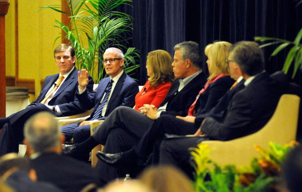 Sutter Roseville Medical Center CEO Patrick Brady, left, listens as Western Health Advantage's Garry Maisel speaks during a panel discussion hosted by the Sacramento Business Journal.