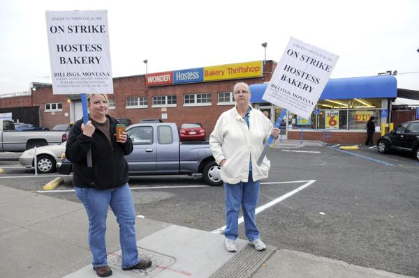 Gloria Rea and Becky Harrison picket Thursday outside the Hostess Wonder Bread factory at Arden. Hostess announced Friday that it would be shutting operations, putting its workforce of 18,500 out of work.