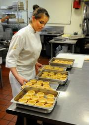 Taylor Lovelace readies pot pie shells for a seating at The Kitchen.