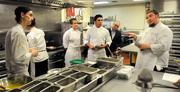 The chef crew of The Kitchen meets before serving guests at a seating on Jan. 23.