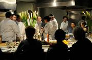 Chefs at The Kitchen go over the dietary lineup before the dinner service.