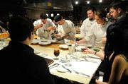 The Kitchen staff plate lobster bisque. From left, Paul Di Pierro, Joshua Thomas, Mike Ward, Taylor Lovelace and Eric Philbin. In the foreground, guests Naveed Safi and Citra Mulia watch the plating.