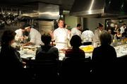 The Kitchen executive chef Randall Selland explains the evening's schedule to guests.