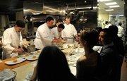 The Kitchen staff prepares pot pie. From left, Joshua Thomas, Mike Ward, Paul Di Pierro, Eric Philbin and executive chef Randall Selland.