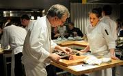 Executive chef Randall Selland cuts beef tenderloin to order with Taylor Lovelace.