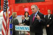 During his visit to Sacramento, U.S. Secretary of Transportation Ray LaHood discussed the Obama administration's policies on rail development with Siemens vice president of strategic business development Robin Stimson.
