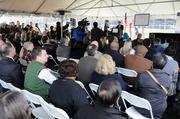 A crowd attends a signing ceremony to commit federal funding to extend Sacramento's existing light-rail Blue Line. The Blue Line extension would add four new stations and a parking garage, offering an alternative to congested Highway 99.