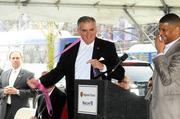 At an announcement of funding to extend Sacramento Regional Transit District's Blue Line, city of Sacramento Mayor Kevin Johnson said U.S. Transportation Secretary Ray LaHood should have a purple tie because he and Councilman Darrell Fong were both wearing purple ties. Here, LaHood exchanges his tie.