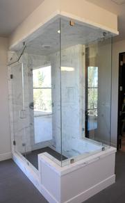 "The master bathroom of a model home at ""Sierra de Montserrat"" includes marble tile and a steam shower."