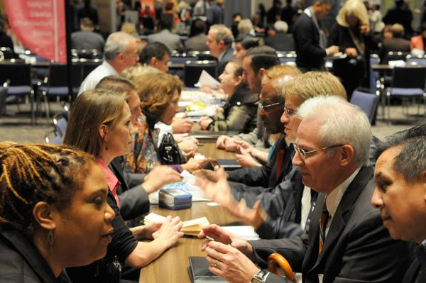 Speed networking participants exchange information at the Sacramento Convention Center. The goal of the Networking Nexus was to introduce as people to as many potential business partners as possible in a short time by moving them through a series of small gatherings.