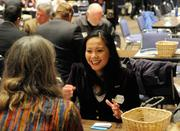 Kelly Teangh, a small business specialist, meets with a speed networking partner. The Networking Nexus matched potential business contacts in 90-second rounds.